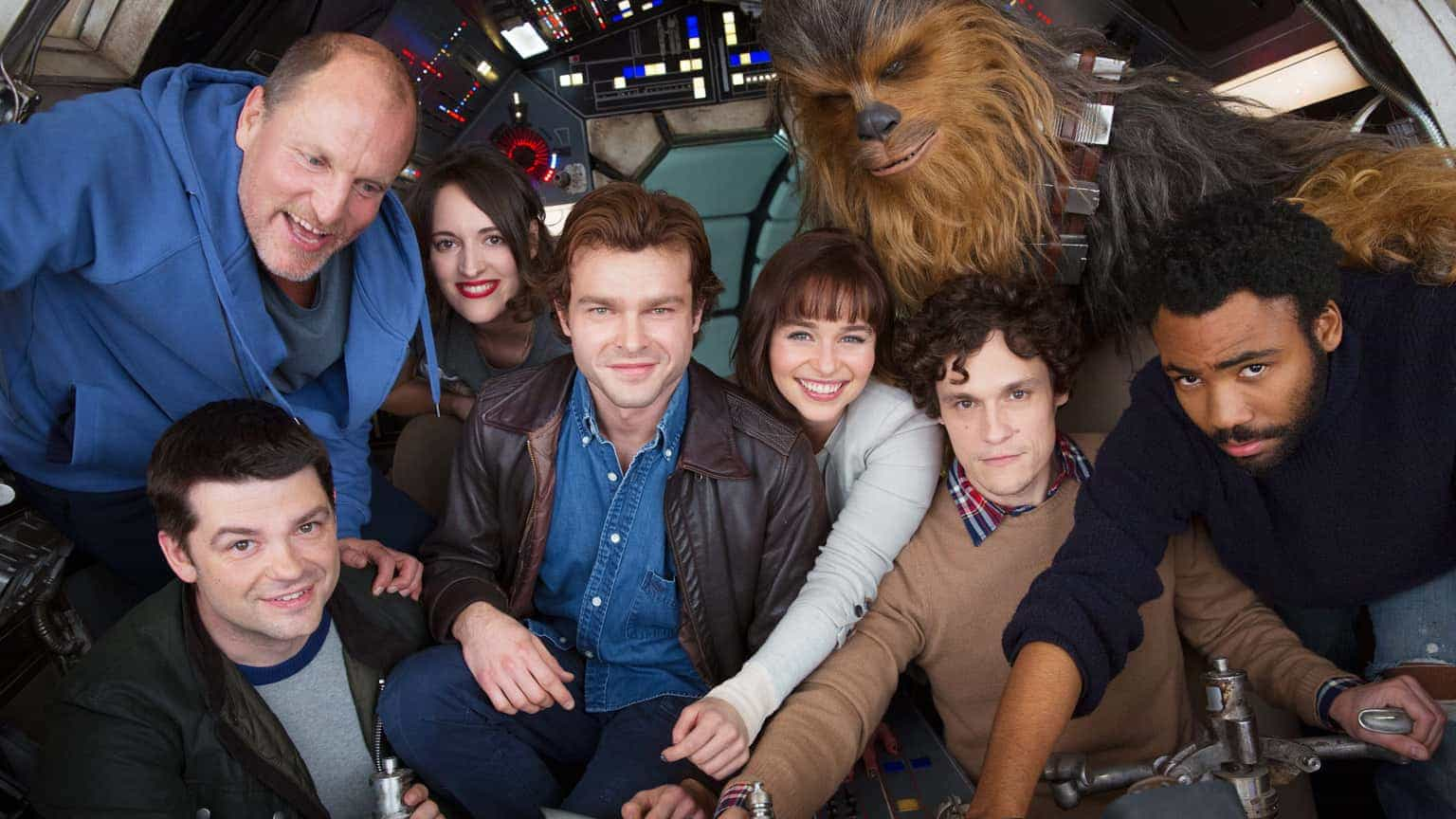Han Solo cast post for a photo in the cockpit of the Millennium Falcon